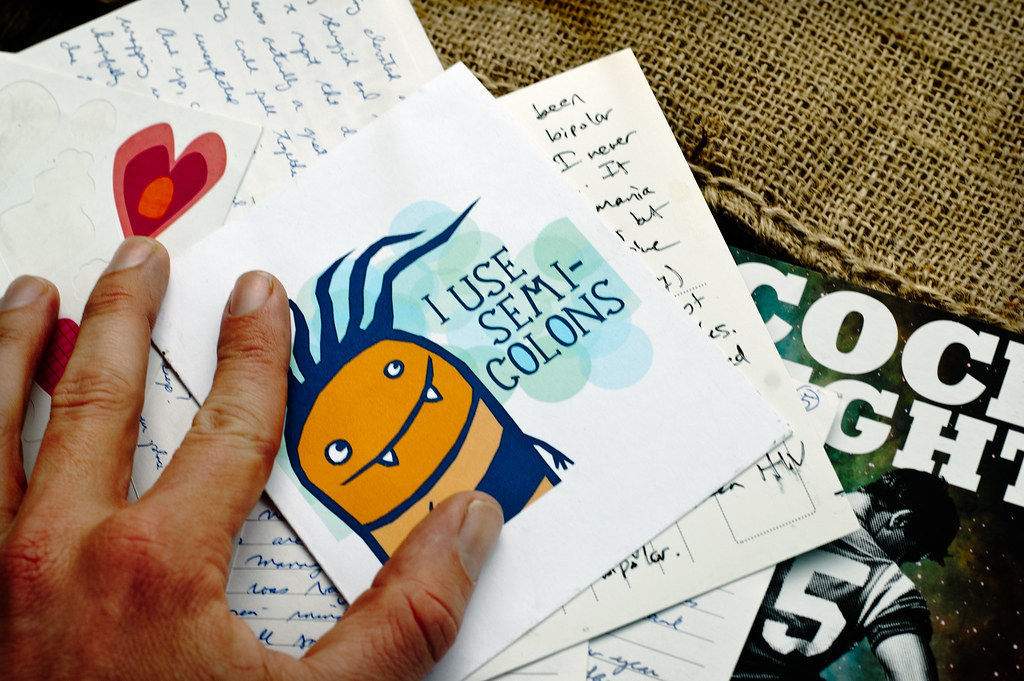 A greeting card with 'I use semi-colons' on